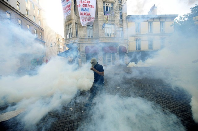 Protestors clash with riot police during a demonstration in Istanbul